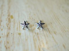 Tiny Starfish Stud Earrings, Sterling Silver Sea Stars, Starfish Sterling Silver Stud, Starfish Earring, Cartilage Stud, Sea Creature by TwiggySilver on Etsy https://www.etsy.com/listing/452483397/tiny-starfish-stud-earrings-sterling