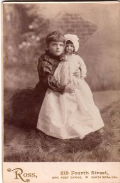 Cabinet-Card-Child-Holding-LARGE-DOLL-MINER-Photographer-Ross-Santa-Rosa-Calif
