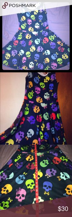 """Colorful Skull Skater Dress This is a colorful skull skater dress that's one of a kind! Perfect with a pair of combat boots, heels, or flats! I'm 5'3"""" and it falls to me knees. This is one of the cutest skull dresses I've ever owned, stretchy material and very comfy! Worn once for 2 hours! Open to offers!                    Not Hot Topic Brand, just used it for more exposure! Hot Topic Dresses"""