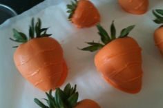 Strawberries dipped in white chocolate (dyed orange) to look like carrots for Easter.