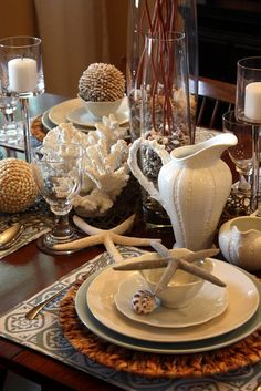 white sea theme table setting...