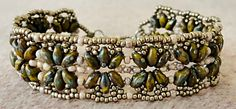 """Linda's Crafty Inspirations-- OCTOPUS BRACELET SuperDuo beads """"Opaque Green Picasso"""" 11/0 seed beads Toho """"Marbled Opaque Pink/Amethyst"""" (TR-11-1203/c) 15/0 seed beads Miyuki """"Duracoat Galvanized Pewter"""" (D4222) Clasp and jump rings  --  Free pattern"""