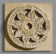 Roundel with radiating palmettes  Period: Sasanian Date: ca. 6th century A.D. Geography: Mesopotamia, Ctesiphon Culture: Sasanian Medium: Stucco
