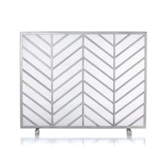 Bold chevrons lend a mid-century look to Ana Reza-Hadden's clean, graphic fireplace screen.  Each screen is handmade by welding multiple iron wires together and a final coat of antique pewter finish. Designed by Ana Reza-HaddenHandcraftedIron with antique pewter finishWipe clean with damp clothMade in India.