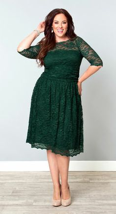 The Scalloped Luna Lace Dress in Green Ivy has a a full A-line skirt and ruched torso and scalloped hem for $158 in sizes 0x to 5x or sizes 10-32 at Kiyonna ( kiyonna.com)