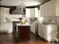 Reader's kitchen from Cote de Texas, will be featured in BHG Real Life Kitchens issue.  Not a fan whatsoever of granite, but love the backsplash and the dark paint above the cabinets