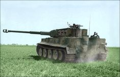 Weighing 56 tons of the best quality German rolled homogeneous nickel-steel plate armor, and carrying the dreaded 88 mm KwK 36L/56 high-velocity gun, theTiger I was designed to dominate the battlefield.    Above, a PzKpfw.VI Tiger I, of s-SSPzAbt.101 on maneuvers at Normandy, 1944. Photo: Bundesarchiv (Colorized).