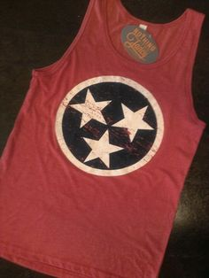 This tri-blend uni-sex tank top is in vintage red with the Tennessee state flag tri-star in navy and white ink. Sizes XS-XXL will be available all summer 2014. Nothing Too Fancy - Knoxville, TN