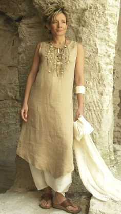 Beige linen tunic  sarouel linen mixte  Silk shawl (sold out)  Necklace: leather, horn Zebu, shells and fish vertebrae beads
