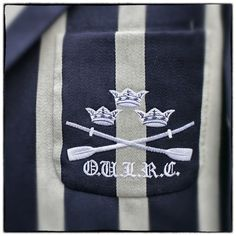 Image has been processed using a digital filter) The badge of the Oxford University Light Rowing Club is seen on a blazer on July 3, 2014 in Henley-on-Thames, England.  Opening yesterday and celebrating its 175th year, the Henley Royal Regatta is regarded as part of the English social season and is held annually over five days on the River Thames. Thousands of rowing fans are expected to come to watch races which are head-to-head knock out competitions, raced over a course of 1 mile, 550…