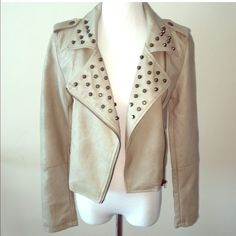 Leather jacket Faux leather jacket. Euc like new! So so so cute. Only selling bc it is too small for me now. Color is a beige/tan/ light grey. I also have the fringe skirt in picture for sale!reasonable offers considered  50% of my listed price is not considered reasonable Jackets & Coats