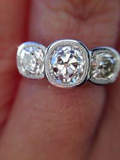 2.04ctw Antique Cushion Cut Diamond Three Stone Ring in Sholdt Bezel Setting