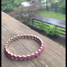 Raspberry bangle Preloved in great condition. Pink colored stone with gold. Towne & Reese Jewelry Bracelets