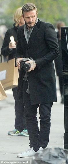 David Beckham snaps pictures of Harper on London day out   Daily Mail Online