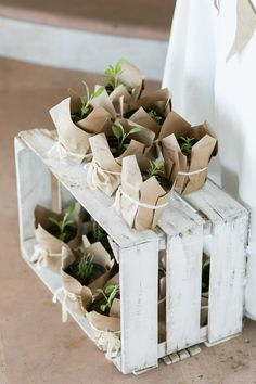 Favors - sage, lavender and thyme plants wrapped in recycled brown paper with a ribbon. A gift of life for a baby shower! photo by http://anaandjerome.com
