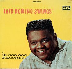 """""""Fats Domino Swings"""" (1958, Imperial).  Contains """"Blue Monday,"""" """"Blueberry Hill,"""" """"I'm In Love Again,"""" """"My Blue Heaven,"""" """"I'm Walkin',"""" """"Ain't It A Shame"""" and """"Whole Lotta Loving.""""  (See: http://www.youtube.com/watch?v=4xDceKm-IeU)"""