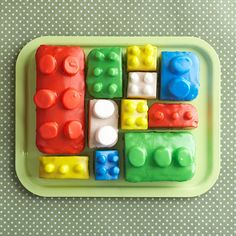 Building Blocks Cake  To make this adorable no-bake dessert, top frozen pound cakes with marshmallows to create the interlocking Legos. Brightly colored powdered sugar frosting tinted with paste food coloring adds realistic shine.