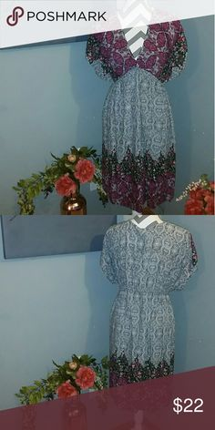 Floral Dress/Coverup Used but in great shape. Elastic waist. Dresses