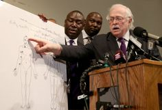 Dr. Michael Baden points to an autopsy diagram during a press conference Monday in Ferguson, Mo. Baden was hired to conduct an independent preliminary autopsy on Brown.