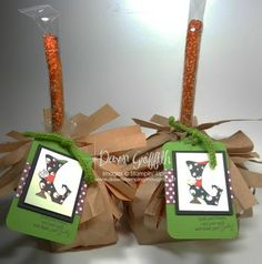 Cute treat holder from Dawns Stamping Studio - witches' broom made with a lunch bag.  Get info at http://dawnsstampingthoughts.typepad.com/dawns_stampin_studio/2012/10/witches-popcorn-broom-video-.html