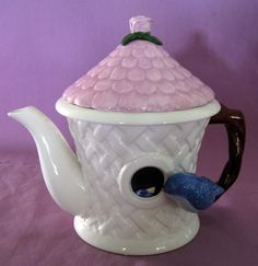 Teleflora Bluebird and Lattice Birdhouse teapot, with pink thatched roof l id, twig branch shape handle, ceramic