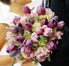 Mala carried a bouquet of her favorite flower -- purple tulips -- mixed with a few lime green hydrangeas. The round posy-style bouquet was tied off with a braided, ivory, satin ribbon adorned with pearl buttons. Tulip Wedding, Purple Wedding Flowers, Flower Bouquet Wedding, Bridesmaid Bouquet, Bridal Bouquets, Spring Wedding, Purple Bouquets, Bridesmaids, Tulip Bouquet