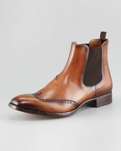 Wing-Tip Chelsea Boot by Prada at Bergdorf Goodman.