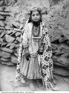 Iran | A little Qajar girl adorned in silver jewellery. Photo by Antoin Sevruguin. Late 19th century