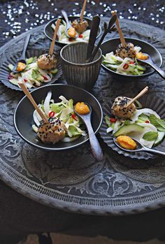 White miso and black sesame chicken balls with fennel and cucumber salad and carrot dressing