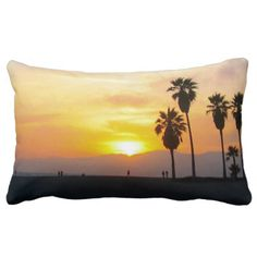 Sunset  throw pillow cushion, home decor. - This photo shows a beautiful golden yellow, orange, red, and purple sunset over the Pacific Ocean in Venice Beach California. The scene has silhouettes of people walking along the famous boardwalk near the towering palm trees lining the shoreline of sand and sea.