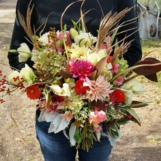 Fall bouquet using lisianthus, dusty miller, dahlia, hydrangea, grass, bittersweet, viburnum.