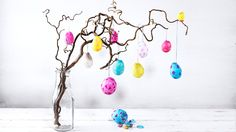 Papier-mâché eggs hanging from branch | Easy papier-mâché Easter eggs | Tesco Living