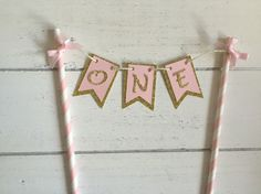 A personal favourite from my Etsy shop https://www.etsy.com/listing/285818017/pink-and-gold-one-cake-banner-first