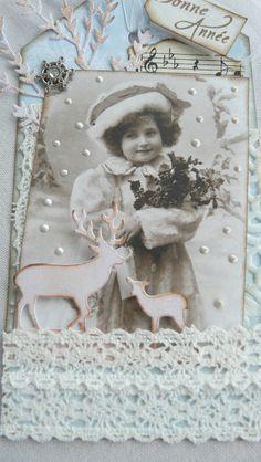 Voilà un tag Bonne Année pour mon amie Marie Laure . On a l'impression que cette petite fille est dans la neige , merci à Léna...
