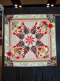 I really like the curved elements in the corner of this feathered star quilt by Diana Nownes.  I think I could use fans like these in the corners of my (much) smaller quilt.