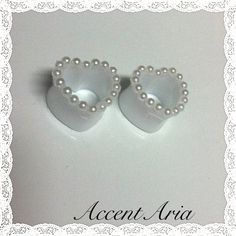 Hey, I found this really awesome Etsy listing at http://www.etsy.com/listing/155499858/pearl-heart-tunnel-plugs
