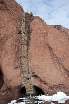 Permian Redbeds - Red Fjord, Northeast Greenland National Park - Cut by dyke that intruded during period of Paleogene volcanism Formations Rocheuses, Greenland Travel, Natural Phenomena, Science And Nature, Natural Wonders, Natural World, Amazing Nature, Statues, Nature Photography