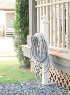 Want an inexpensive and esthetically pleasing way to store your garden hose?Sure you can buy something plastic and fancy (and expensive) from a home improvement store - but where's the fun in that?I saw this tutorial