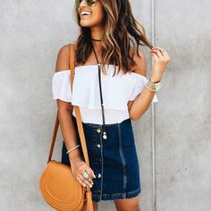 such a cute summer outfit- I love the bright white and cute bag with the denim skirt