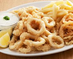 Schnitzels and seafood dishes are served with Spur-style crispy onion rings and chips OR baked potato. Replace your chips with a garden salad for a healthier alternative. Lolly Cake, Fried Calamari, Crispy Onions, Onion Rings, Seafood Dishes, Healthy Alternatives, Baked Potato, Fries, Menu
