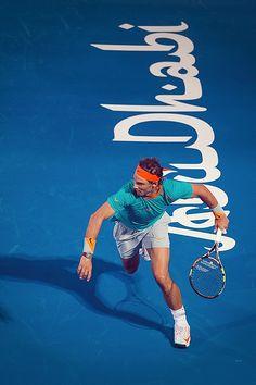 Rafael Nadal in action in Abu Dhabi, Nadal Tennis, Atp Tennis, Rafael Nadal, Tennis World, Sports Personality, Tennis Stars, Fun Hobbies, Sports Photos, Sport