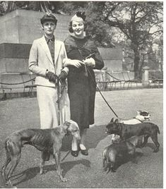 Debo and Decca Mitford with their dogs.