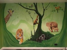 This jungle mural was painted on one feature wall in a little girls bedroom. We used various shades of green to build up the background and then added lots of different animals including a giraffe, a tiger, a baby gorilla and orangutan, a mother elephant and her baby and some brightly coloured birds.