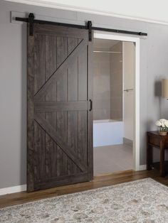 Paneled Manufactured Wood Finish Continental Barn Door with Installation Hardware Kit Barn style doors will create a focal point to any interior. Their barn doors of today offer innovation, fun Barn Door In House, Diy Barn Door, Sliding Barn Door Hardware, Door Latches, House Front, Gate Hardware, Door Knobs, Glass Barn Doors, Sliding Glass Door