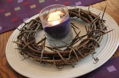 Lenten centerpiece - grapevine wreath, toothpicks stained dark (or colored with a brown marker like we did at my house), purple candle inside