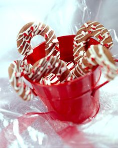 The crisp chocolate cookie cutouts are drizzled with melted white chocolate and then sprinkled with chopped peppermint candies. #christmascookies #decoratedcookies #forkids #cuteholidaycookieideas #easy #bhg