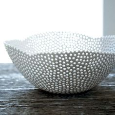 porcelain bowl. individually driled holes! whoa.