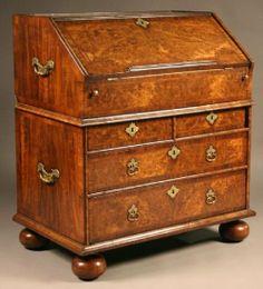 A Rare Early Queen Anne Burr Walnut Bureau