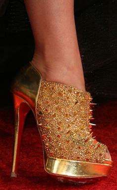 Olivia Wilde in gold Christian Louboutin 'Bridget's Back' ankle boots
