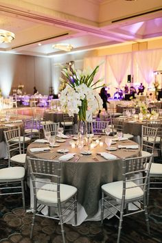 Stand out with this large arrangement of white lilies and orchids. Tall Centerpiece, Centerpiece Ideas, Centerpieces, Table Decorations, All White Wedding, Grand Hyatt, White Lilies, Wedding Table Settings, Atlanta Wedding